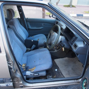 Proton Saga car rental - interior shot of drivers seat