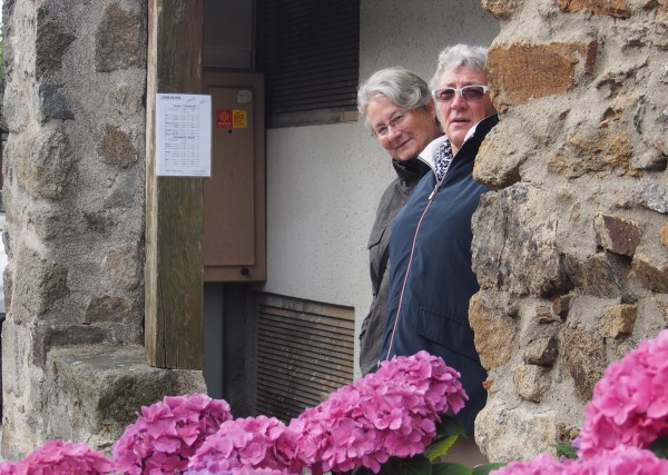 Sue and Connie waiting at the Saissac bus stop for the bus to Carcassonne