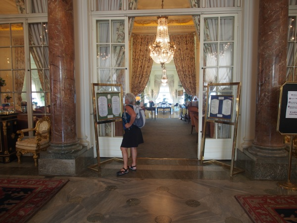 Connie is checking the menu in the Hotel de Palais