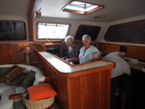 Lorraine and Connie in the galley of Katani getting the appies ready
