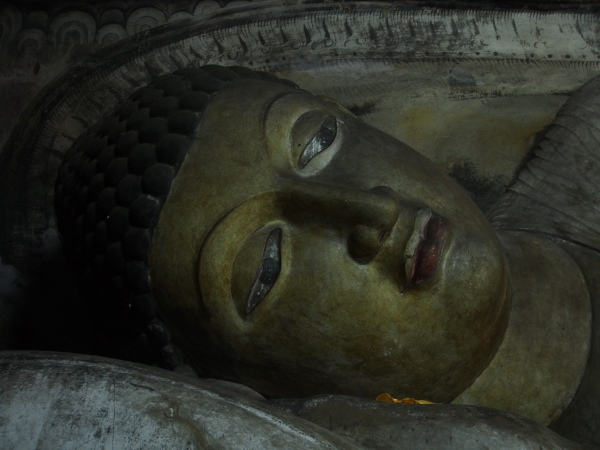 One of hundreds of Buddhas carved inside the caves of Dambulla