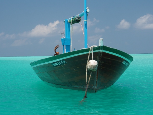 Quintessential photo of a Maldivian boat at anchor