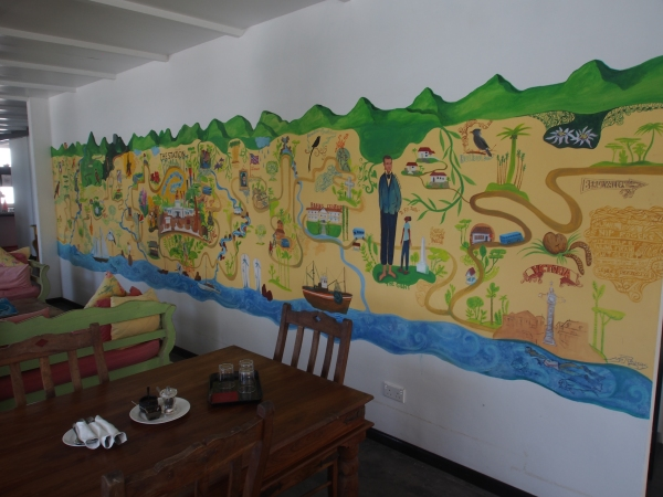 The lounge dining area has a great mural map of Mahe