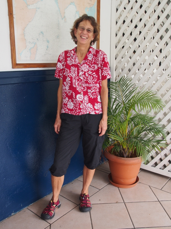 Marcia dressing very tropical with Fijian cotton print shirt, REI capris and Keen shoes